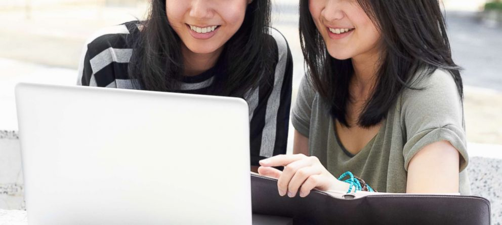 PHOTO: Two students sitting outside together appear in this undated stock photo.