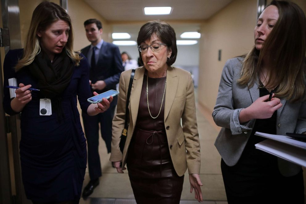 PHOTO: Sen. Susan Collins (R-ME) talks to reporters as she heads to the Capitol for the weekly Republican policy luncheon, March 5, 2019.