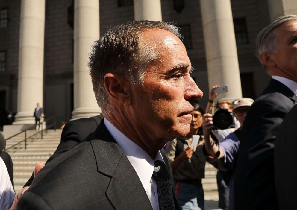 PHOTO: Rep. Chris Collins walks out of a New York court house after being charged with insider trading on Aug. 8, 2018 in New York City.