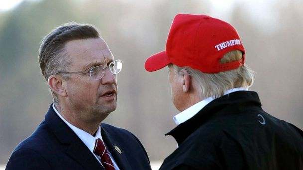 PHOTO: President Donald Trump greets Rep. Doug Collins as he arrives on Air Force One, March 6, 2020, at Dobbins Air Reserve Base in Marietta, Ga.