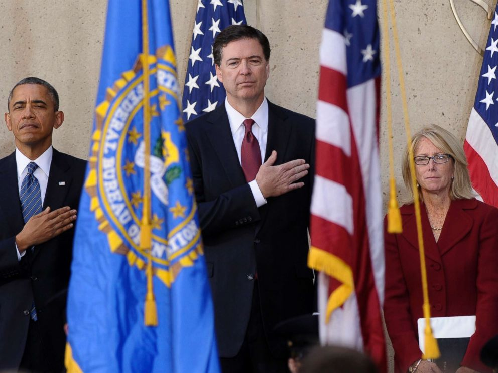 PHOTO: From left, President Barack Obama stands with James Comey and his wife Patrice Failor during the singing of the National Anthem at Comeys installation as FBI Director, Monday, Oct. 28, 2013, at FBI Headquarters in Washington, D.C.