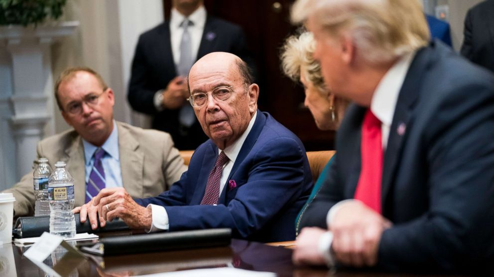 Commerce Secretary Wilbur Ross speaks to President Donald Trump during the first meeting of the President's National Council for the American Worker at the White House in Washington, Sept. 17, 2018.