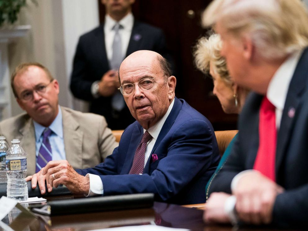 PHOTO: Commerce Secretary Wilbur Ross speaks to President Donald Trump during the first meeting of the Presidents National Council for the American Worker at the White House in Washington, Sept. 17, 2018.