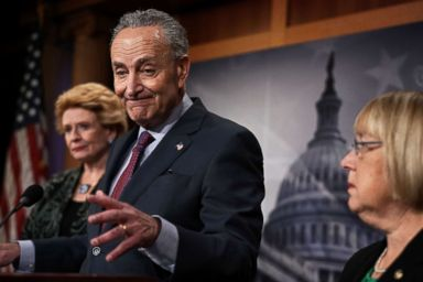 PHOTO: Senate Minority Leader Chuck Schumer speaks as Sens. Debbie Stabenow, left, and Patty Murray, right, listen during a news conference at the Capitol Dec. 21, 2017 in Washington, DC.