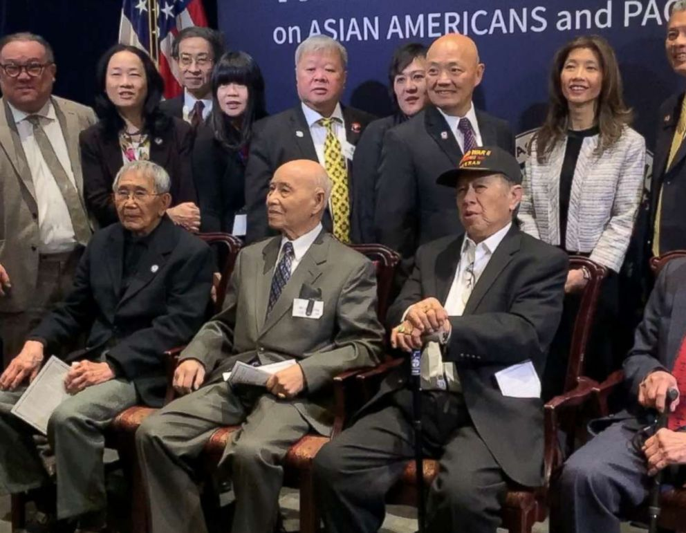 PHOTO: James Eng, Harry Jung and Henry Lee, front row, pose for photos with members of the Chinese American Citizens Alliance after being awarded with the Congressional Gold Medal in Washington, Jan. 29, 2019.