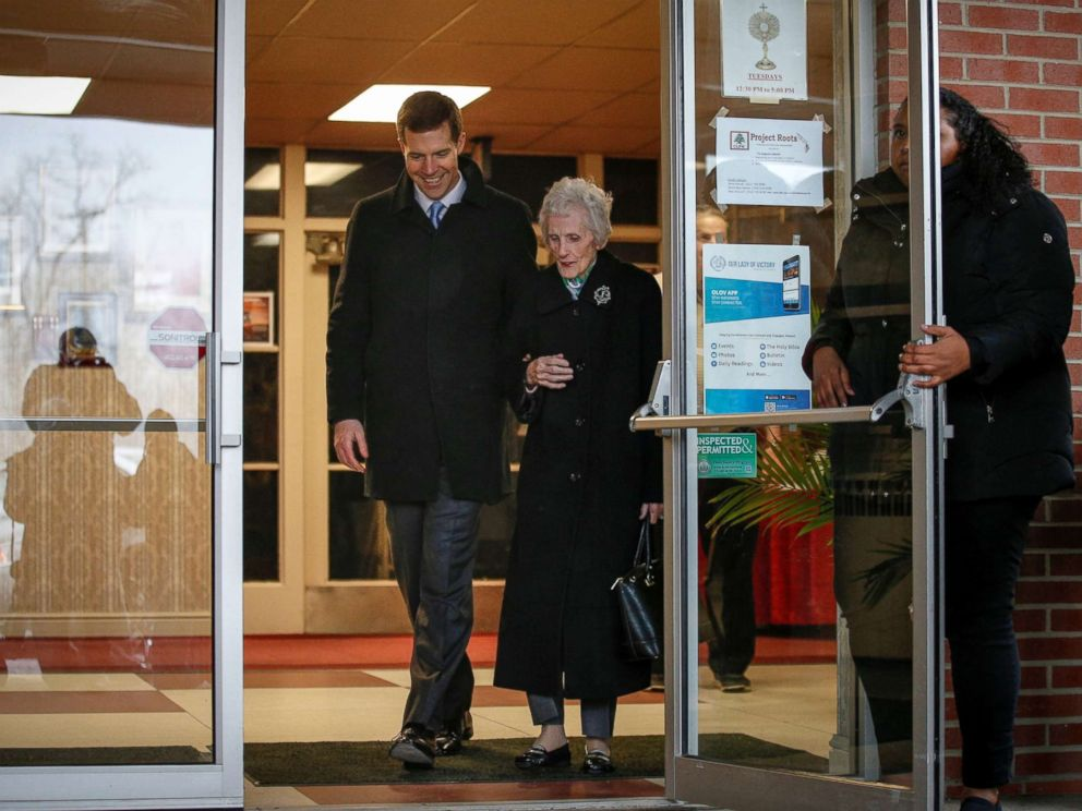 PHOTO: Democratic congressional candidate Conor Lamb exits after taking his his grandmother, Barbara Lamb, to vote in Carnegie, Pennsylvania, March 13, 2018.