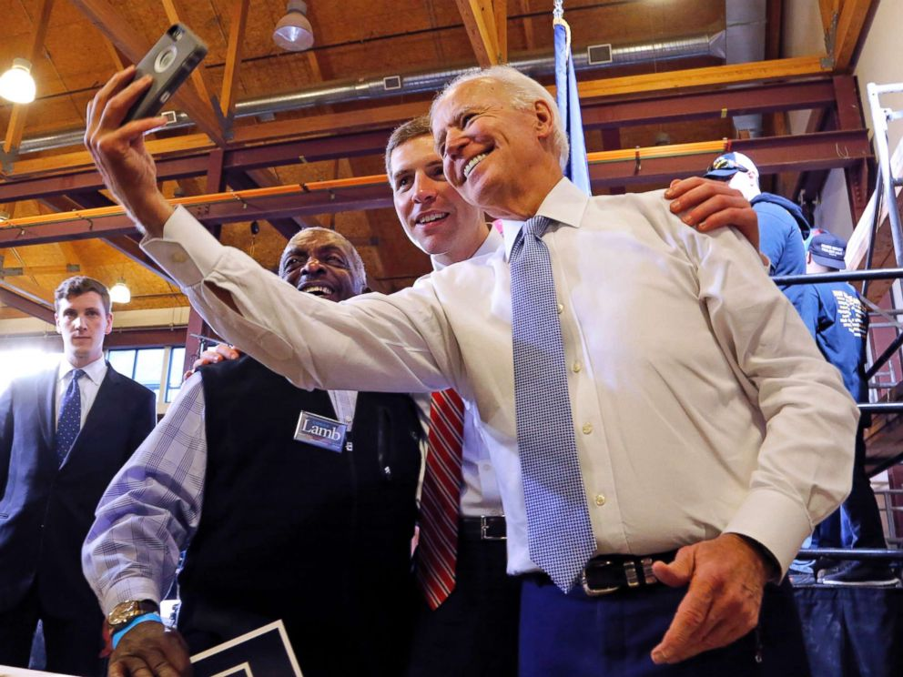 PHOTO: Conor Lamb, center, the Democratic candidate for the March 13 special election in Pennsylvanias 18th Congressional District, and former Vice President Joe Biden pose for a selfie with a supporter during a rally in Collier, Pa., March 6, 2018.