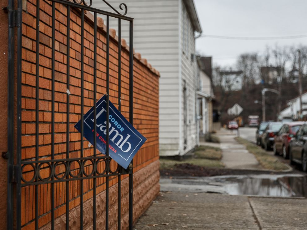 PHOTO: A sign showing support for Congressional candidate Conor Lamb hangs from a gate in the town of Carnegie, Pa., Feb. 16, 2018.