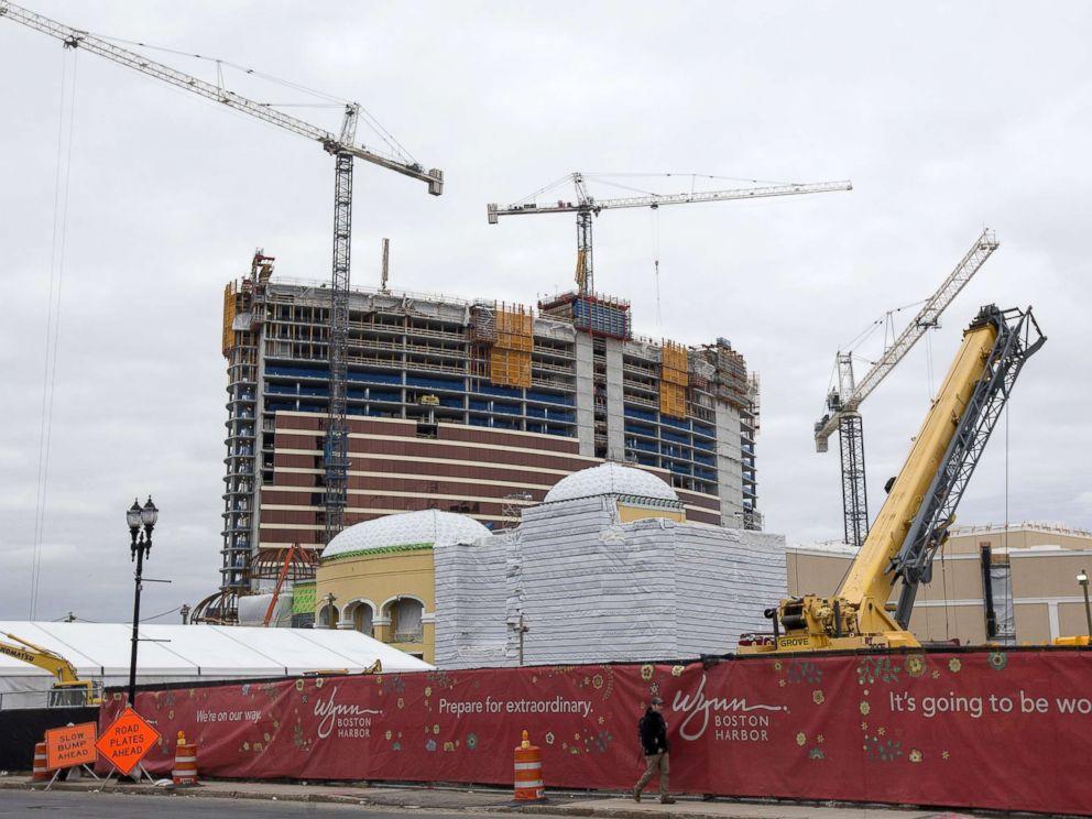 PHOTO: A pedestrian walks past the Wynn Boston Harbor Resort Casino under construction in Everett, Mass., Feb. 7, 2018.