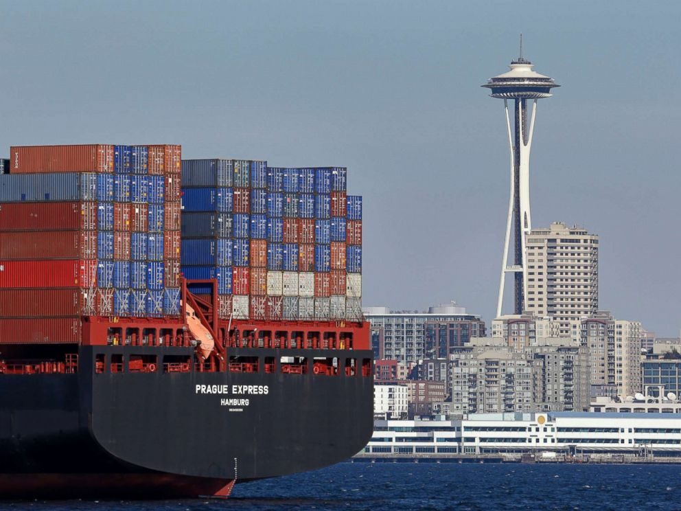 PHOTO: The Space Needle towers in the background beyond a container ship anchored in Elliott Bay near downtown Seattle, Feb. 15, 2015.