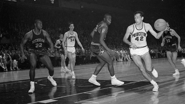 PHOTO: Princeton's Bill Bradley (#42) scoots around Michigan's Cazzie Russell at the ECAC Holiday Basketball Festival at Madison Square Garden, Dec 31, 1964 in New York, NY.