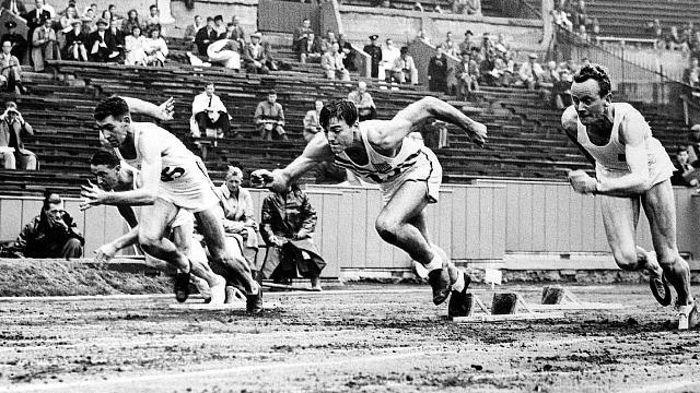 PHOTO: Bob Mathias, center, runs the 100-meter (heat four) in the 1948 London Olympics, Aug. 7, 1948, London, England, UK. The men are shown at the staring line as the starter gun goes off.