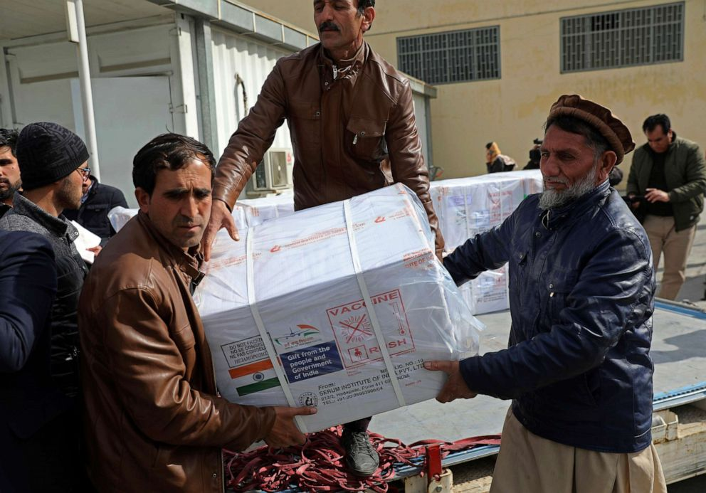 PHOTO: Afghan health ministry workers unload boxes of the AstraZeneca coronavirus vaccine donated by the Indian government to Afghanistan, at the customs area of the Hamid Karzai International Airport, in Kabul, Afghanistan.