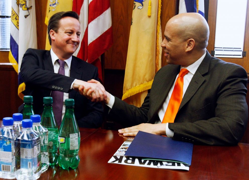PHOTO: British Prime Minister David Cameron shakes hands with Mayor Cory Booker at City Hall during a meeting in Newark, March 15, 2012.