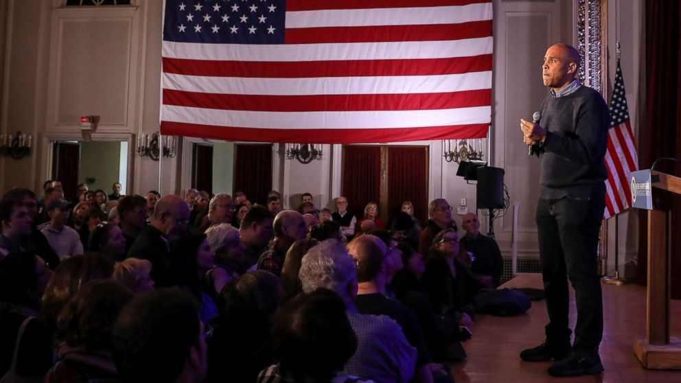 U.S. Sen. Cory Booker, D-N.J., pauses while sharing a personal story while speaking at a post-midterm election victory celebration in Manchester, N.H., on Sunday, Dec. 8, 2018.