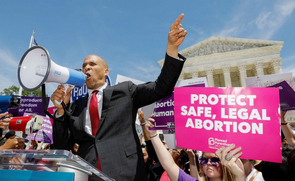 PHOTO: Democratic presidential candidate Sen. Cory Booker addresses abortion rights activists during a rally outside the U.S. Supreme Court in Washington, D.C., May 21, 2019.