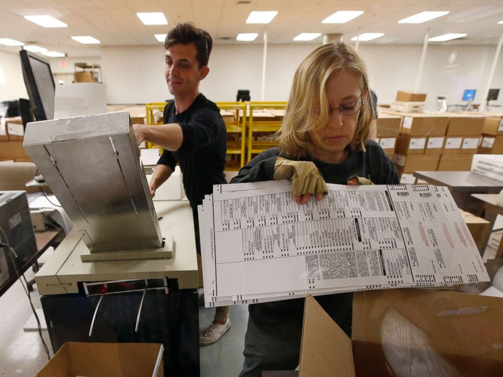 PHOTO: Workers organize ballots at the Maricopa County Recorders Office Thursday, Nov. 8, 2018, in Phoenix.