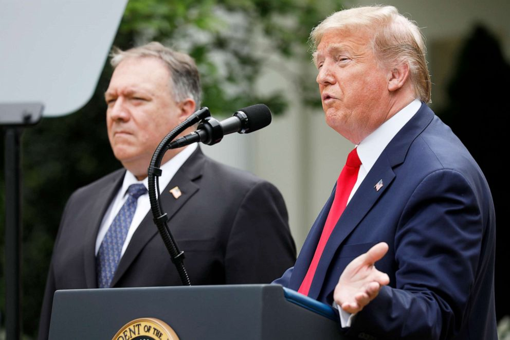 PHOTO: President Donald Trump speaks as Mike Pompeo, U.S. secretary of state, left, listens during a news conference in the Rose Garden of the White House, May 29, 2020.