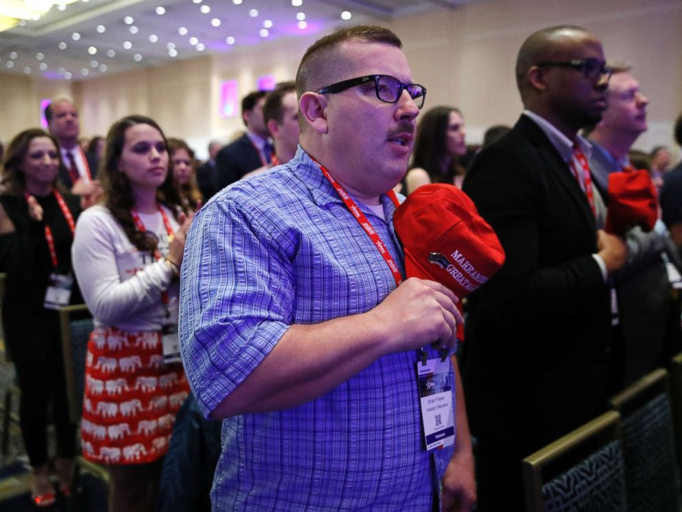 PHOTO: Brian Frayer, of Waldorf, Md., holds a Make America Great Again hat over his heart during the national anthem during the Conservative Political Action Conference, at National Harbor, Md., Feb. 23, 2018.