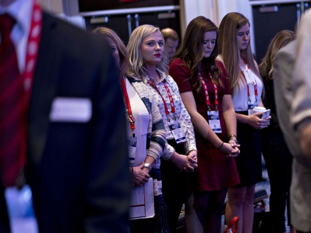 PHOTO: Attendees listen to a prayer at the Conservative Political Action Conference in National Harbor, Md., Feb. 22, 2018