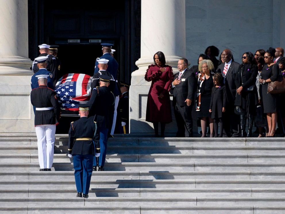 PHOTO: Maya Rockeymoore Cummings, center, watches with family and friends as the casket of Rep. Elijah Cummings arrives at the U.S. Capitol to lie in state on Oct. 24, 2019, in Washington D.C.