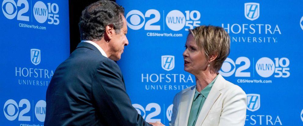 PHOTO: New York Governor Andrew Cuomo and Democratic gubernatorial candidate Cynthia Nixon shake hands before a gubernatorial debate at Hofstra University in Hempstead, New York, Aug. 29, 2018.