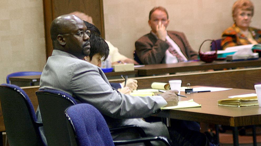 Curtis Giovanni Flowers, left, listens to testimony in his third capital murder trial in Winona, Miss., Feb. 6, 2004.
