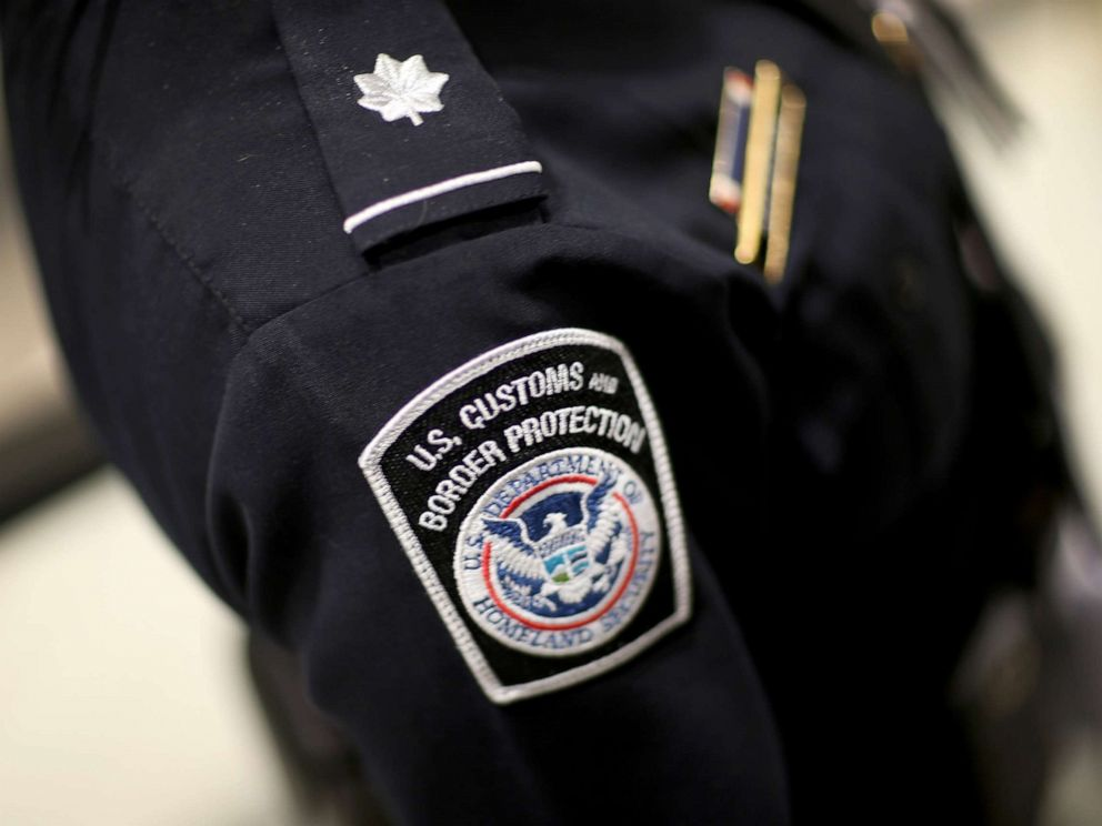 PHOTO: A U.S. Customs and Border Protection officers patch is seen as they unveil a new mobile app for international travelers arriving at Miami International Airport, March 4, 2015 in Miami.