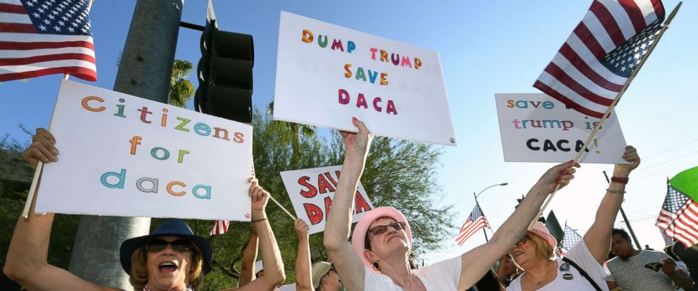 "PHOTO: Deborah Shomsky, center, of Nevada joins immigrants and supporters during a ""We Rise for the Dream"" rally to oppose U.S. President Donald Trumps order to end DACA in Las Vegas, Sept. 10, 2017, in Las Vegas"