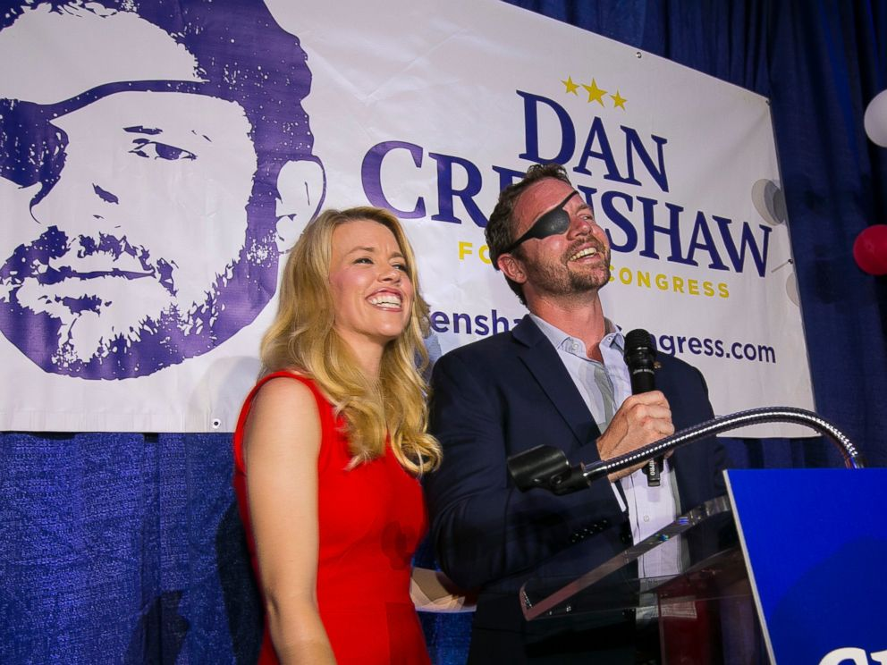 PHOTO: In this Tuesday, May 22, 2018, file photo, Republican congressional candidate Dan Crenshaw reacts to the crowd with his wife, Tara, as he comes on stage to deliver a victory speech during an election night party at the Cadillac Bar, in Houston.