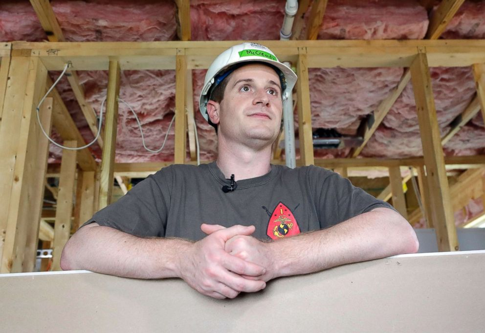 Democratic congressional candidate Dan McCready leans against wallboard as he pauses during a Habitat For Humanity building event in Charlotte, N.C., Sept. 26, 2018.