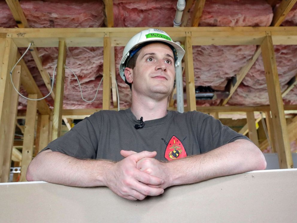 PHOTO: Democratic congressional candidate Dan McCready leans against wallboard as he pauses during a Habitat For Humanity building event in Charlotte, N.C., Sept. 26, 2018.