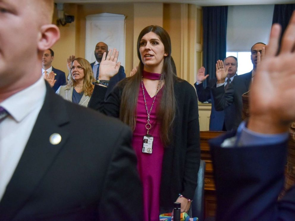 PHOTO: Delegate Danica Roem, center, and other delegates are sworn in on the floor of the House of Delegates at the Virginia State Capitol, Jan. 10, 2018, in Richmond, Va.