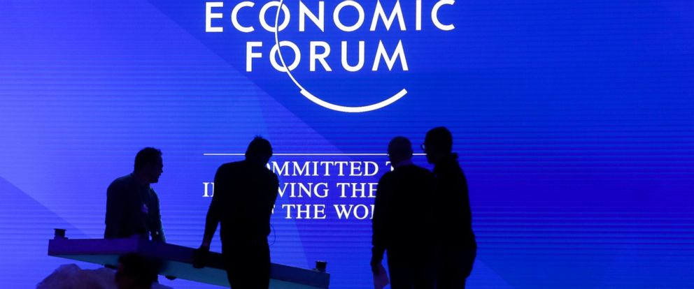 People set up the main stage at the congress center where the annual meeting of the World Economic Forum 2019, WEF, take place in Davos, Sunday, Jan. 20, 2019.