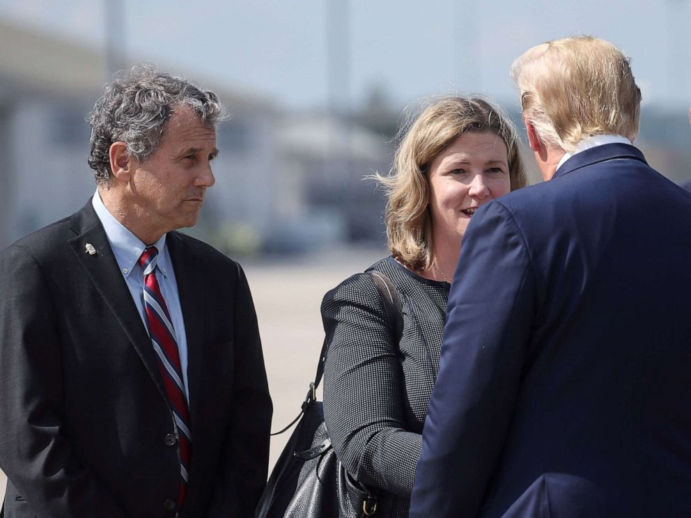 PHOTO: President Donald Trump is greeted by Dayton, Ohio, Mayor Nan Whaley as Sen. Sherrod Brown waits at left, as Trump arrived at Wright-Patterson Air Force Base before visiting the site of a mass shooting in Dayton, Ohio, Aug. 7, 2019.