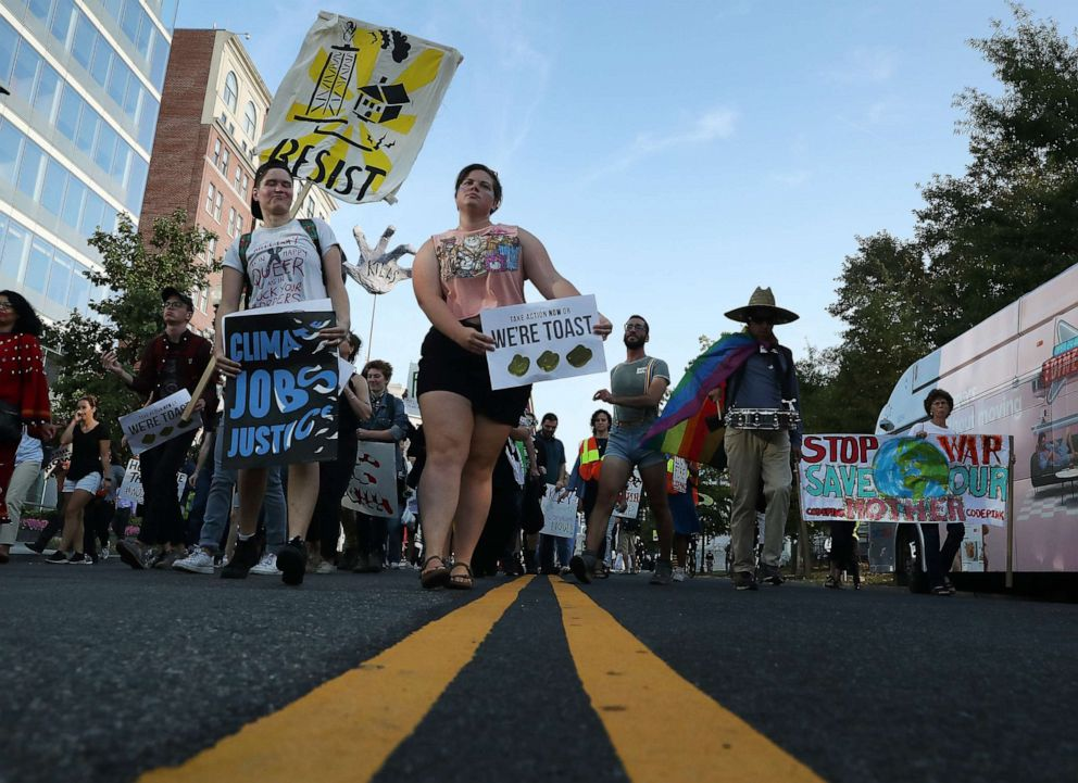 PHOTO: Climate change protesters block traffic during a protest to shut down D.C. on September 23, 2019, in Washington, D.C.