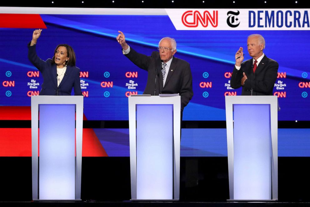 PHOTO: Sen. Kamala Harris (D-CA), Sen. Bernie Sanders (I-VT) and former Vice President Joe Biden raise their hands during the Democratic Presidential Debate at Otterbein University on October 15, 2019 in Westerville, Ohio.