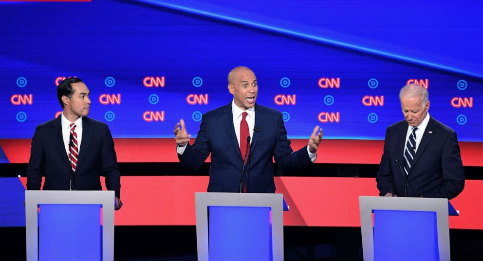 PHOTO: Democratic presidential hopefuls former Secretary of Housing and Urban Development Julian Castro, Sen. Cory Booker and former Vice President Joe Biden speak during the second round of the second Democratic primary debate in Detroit, July 31, 2019.