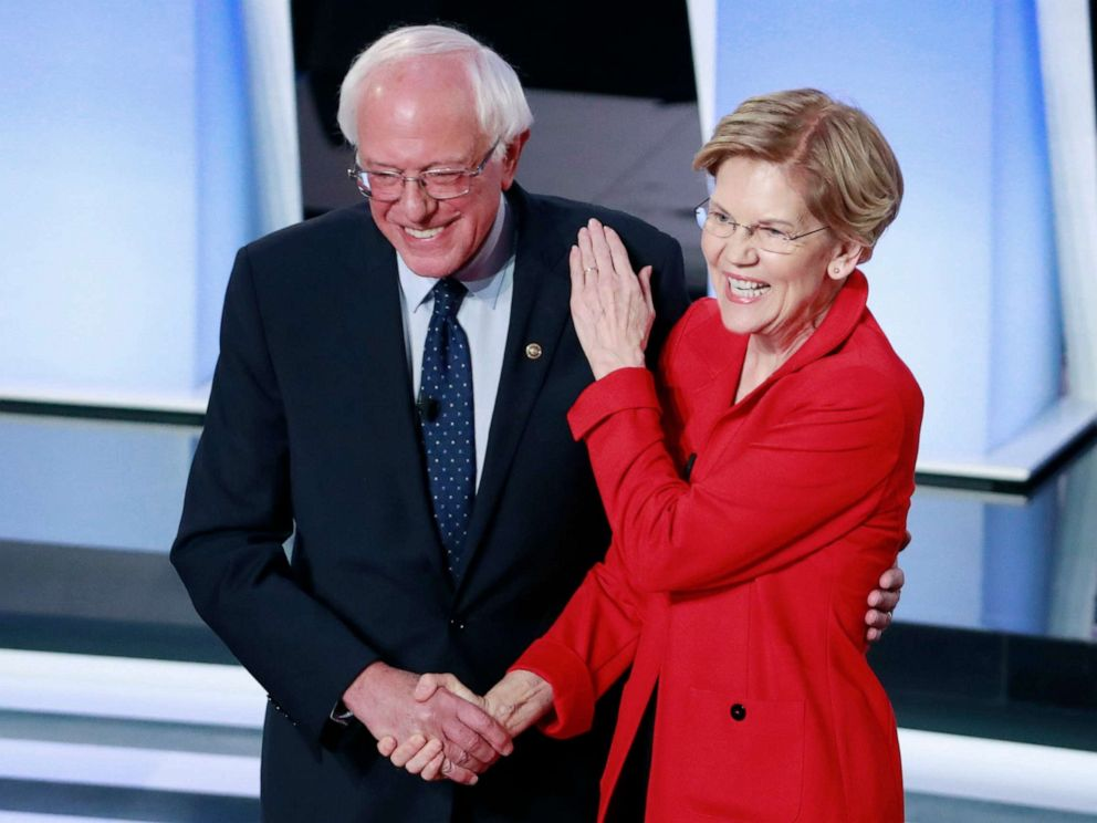 PHOTO: Senator Bernie Sanders and Senator Elizabeth Warren shake hands before the start of the first night of the second 2020 Democratic presidential debate in Detroit, July 30, 2019.