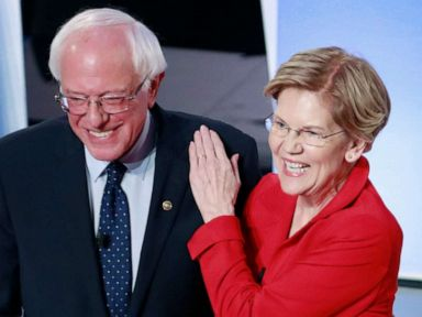 PHOTO: Senator Bernie Sanders and Senator Elizabeth Warren shake hands before the start of the first night of the second 2020 Democratic presidential debate in Detroit, July 30, 2019.