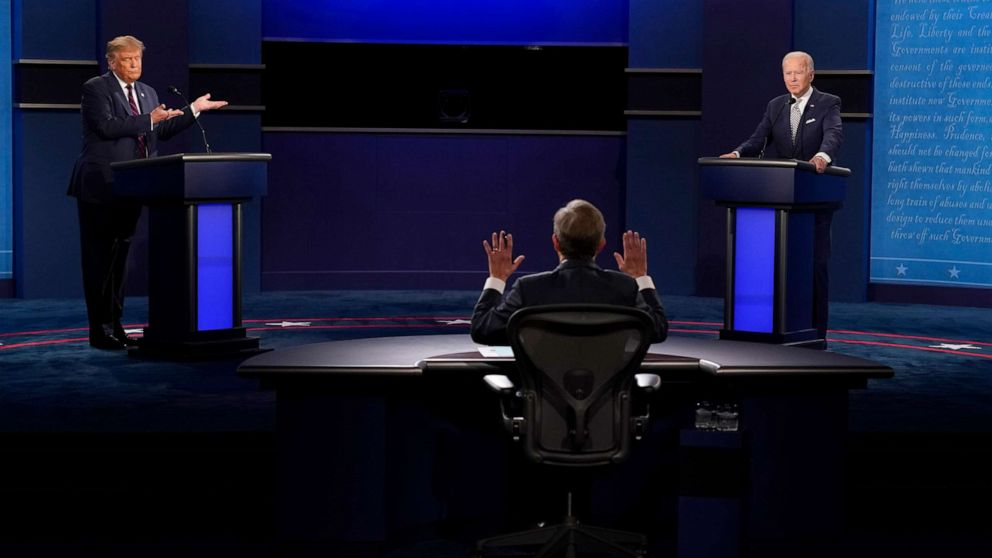PHOTO: Moderator Chris Wallace of Fox News, center, gesturing during the first presidential debate between President Donald Trump, left, and Democratic presidential candidate former Vice President Joe Biden, right, Sept. 29, 2020, in Cleveland.