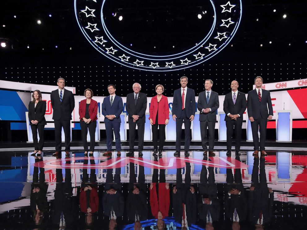 PHOTO: Democratic presidential candidates take the stage at the beginning of the Democratic Presidential Debate at the Fox Theatre, July 30, 2019, in Detroit.
