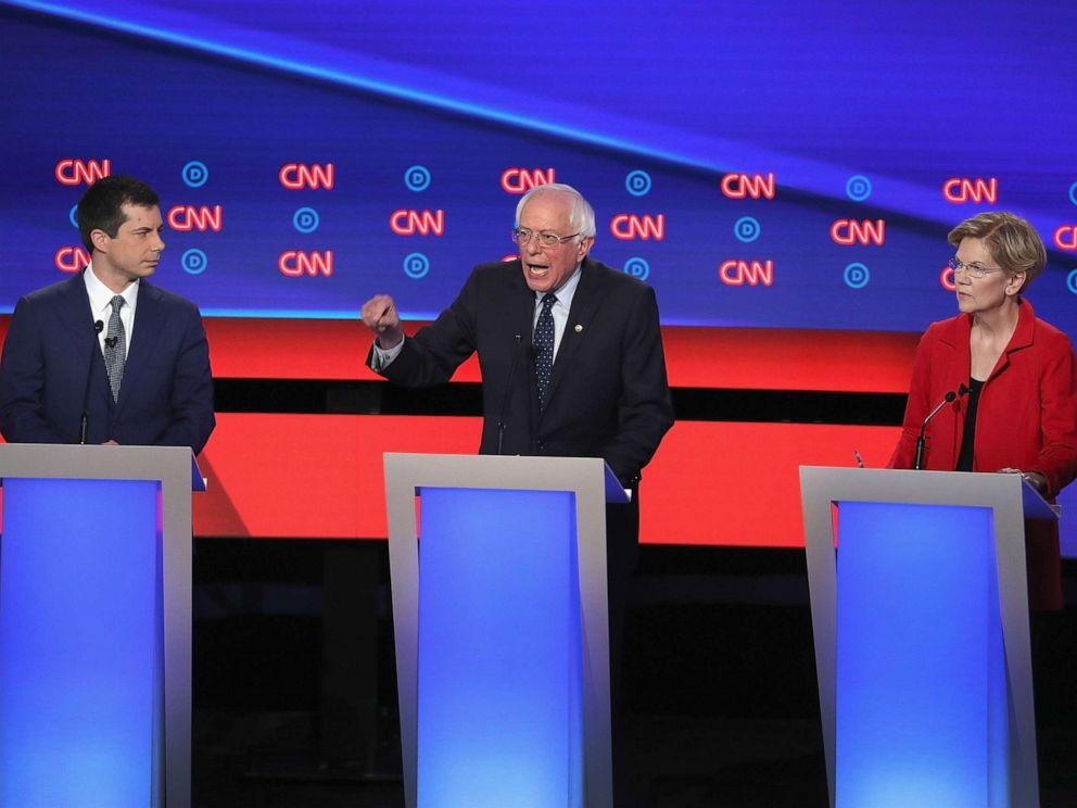 PHOTO: Democratic presidential candidates Sen. Bernie Sanders (I-VT) (C) speaks while Sen. Elizabeth Warren (D-MA) and South Bend, Indiana Mayor Pete Buttigieg (L) listen at the beginning of the Democratic Presidential Debate, July 30, 2019, in Detroit.
