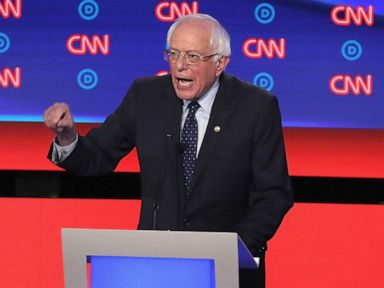 PHOTO: Democratic presidential candidates Sen. Bernie Sanders (I-VT) (C) speaks while Sen. Elizabeth Warren (D-MA) and South Bend, Indiana Mayor Pete Buttigieg (L) listen at the beginning of the Democratic Presidential Debate, July 30, 2019, in Detroit.