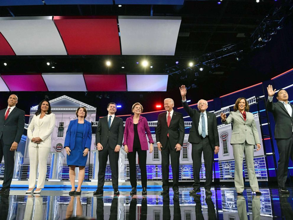 PHOTO: Democratic presidential hopefuls arrive onstage for the fifth Democratic primary debate of the 2020 presidential campaign season in Atlanta, Nov. 20, 2019.