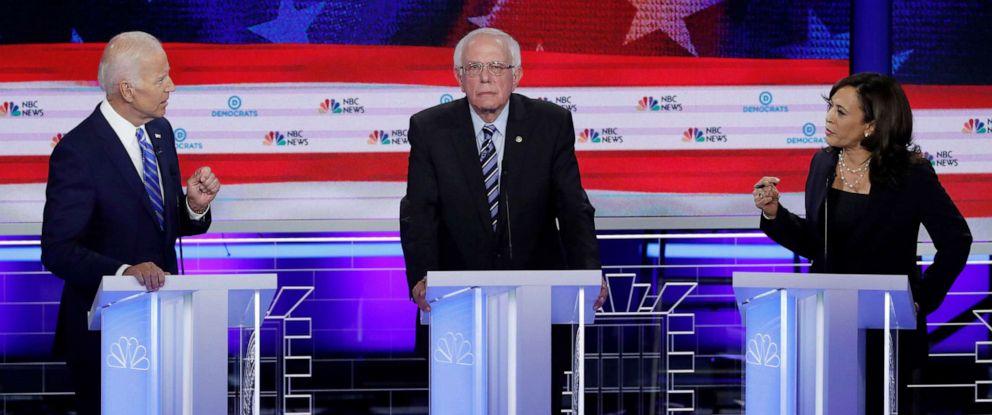 PHOTO: Former Vice President Joe Biden and Senator Kamala Harris debate as Senator Bernie Sanders listens during the second night of the first U.S. Democratic presidential candidates 2020 election debate in Miami, Fla., June 27, 2019.