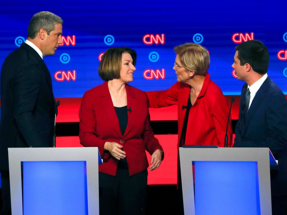 PHOTO:Rep. Tim Ryan, D-Ohio, Sen. Amy Klobuchar, D-Minn., Sen. Elizabeth Warren, D-Mass., and South Bend Mayor Pete Buttigieg talk after the first of two Democratic presidential primary debates, July 30, 2019, in Detroit.