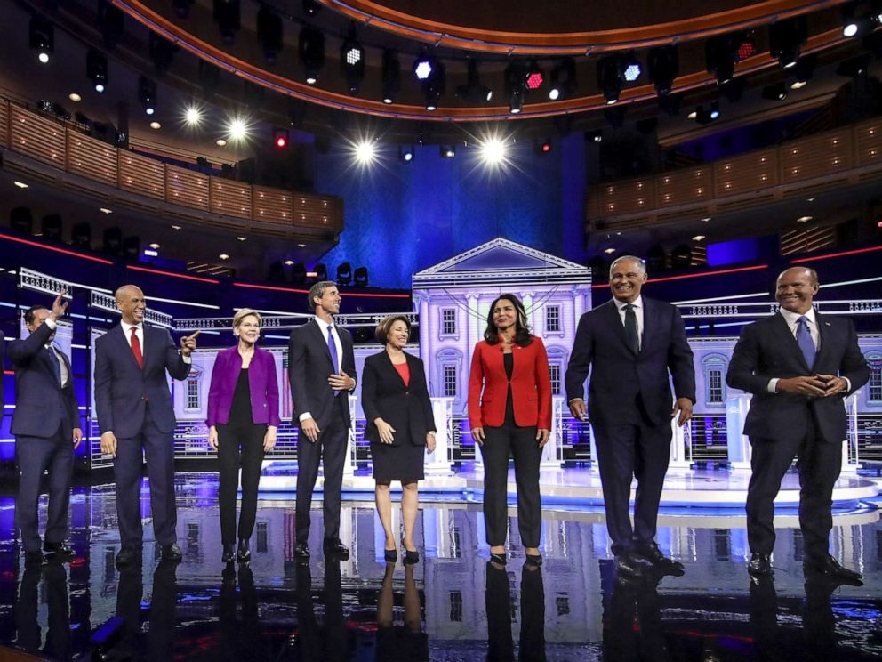 PHOTO: 2020 Democratic presidential candidates take the stage for the first Democratic presidential primary debate for the 2020 election at the Adrienne Arsht Center for the Performing Arts, June 26, 2019 in Miami.