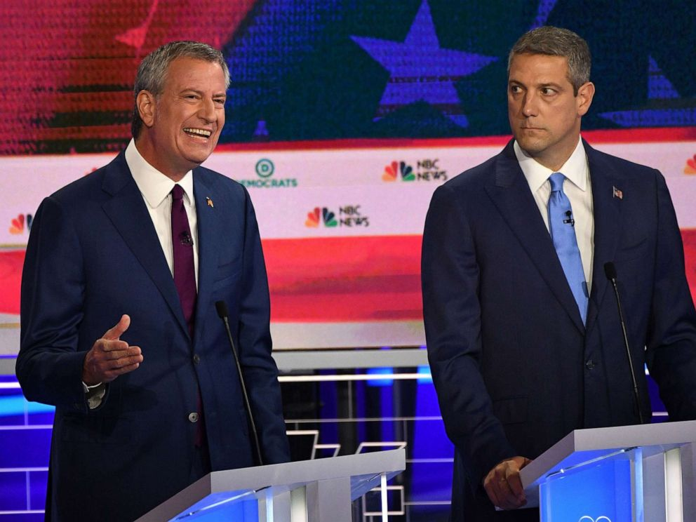 PHOTO: Mayor of New York City Bill de Blasio speaks as Tim Ryan looks on as they participate in the first Democratic primary debate hosted by NBC News at the Adrienne Arsht Center for the Performing Arts in Miami, Florida, June 26, 2019.
