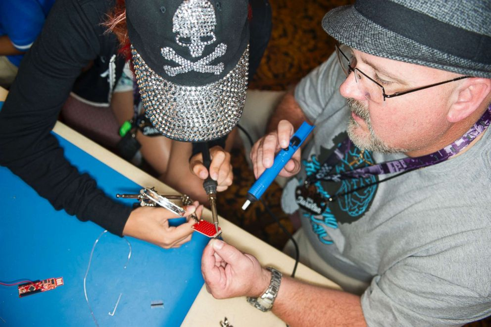 PHOTO: Charles Fox and Leeza solder a DEF CON badge at r00tz Asylum, a hacker kids convention in Ballys Hotel & Casino on Aug. 6, 2016 in Las Vegas.
